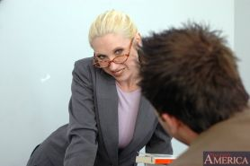 Blond MILF teacher in glasses Devon Lee pleasuring stiff cock in class