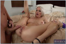 Busty blond MILF Emma Starr seducing younger guy in her bedroom
