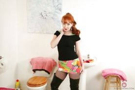 Aged redhead woman by name of Red posing for naughty hose and boot pics