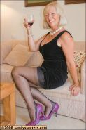Chubby mature in stockings goes horny from wine and fondles her big tits and pussy
