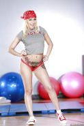 Inked babe Marsha May baring big tits before slipping panties over butt