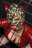 Caged fetish model Latex Lucy licking ass and giving interracial blowjob