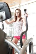 Slim sporty babe Kiera Winters stripping and toying her slit in the gym