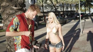 Beautiful all natural blonde Marsha May posing outdoors on boat in bikini