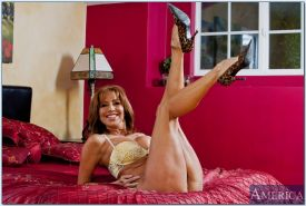 MILF wife with big juggs Tara Holiday spreading her legs naked