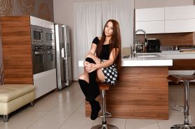 European teen babe Jenny Glam shows off in her socks while undressing