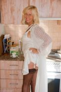 Mature fatty Sandy Spain flaunting solo in black stockings and white lingerie