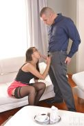 Glasses clad Asian Sharon Lee giving older white man a blowjob