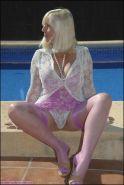 Mature plumper Sandy Spain makes her panties and stockings all wet in the pool