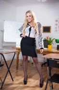 Blonde teacher Brittany Bardot struts in stockings and skirt for babe pics