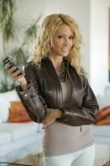 Blonde babe Jessica Drake posing fully clothed in yoga pants and leather