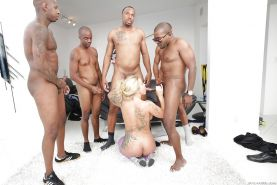 Busty blonde MILF Ryan Conner takes interracial cum on face during blowbang