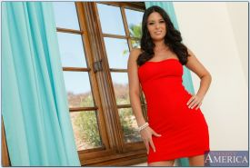 Adorable brunette babe Nikki Daniels taking off her red dress and panties