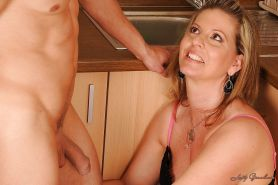 Mature babe Laura Long gives a blowjob and gets fucked in the kitchen