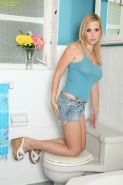 Blonde MILF Kylie Knight baring big tits in bathroom before masturbating