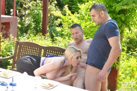 Beautiful blonde chick Victoria Summers giving two men blowjobs outdoors