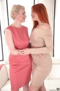 Young redhead Eva Berger hooking up for lesbo sex with mature lady Masha Sun