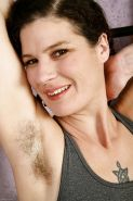 Older woman Sunshine spreading her hairy vagina wide open