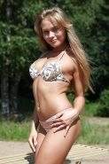 Shapely young babe posing seductively in bikini outdoor