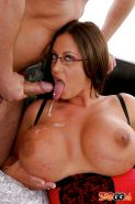 Juggy slut in glasses gets fucked and takes a cumshot on her pierced tongue