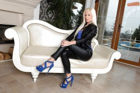 Blonde Euro babe Jessie Volt posing in sexy black leather pants and heels