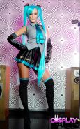 Cosplay girl Elizabeth Bally in pigtails bares big tits & toys bald pussy