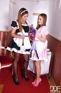 European maid in stockings and high heel clad chick toying lesbian pussies