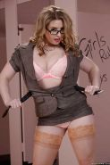 Glasses clad blonde Sunny Lane poses in bathroom wearing underwear and hose