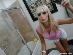 Blonde ex-girlfriend Erica Fontes taking mirror self shots while undressing