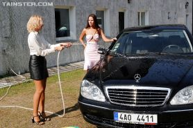 Claudia Rossi has some wet clothed car washing fun with her girlfriend