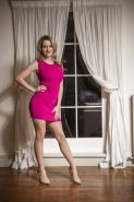 Top rated European babe model Sienna Day posing fully clothed in high heels