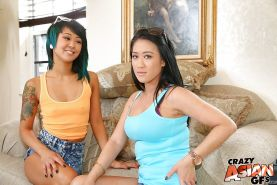 Oriental amateur Saya Song and her girlfriend undress for lesbian sex on sofa
