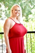 Pierced mature fatty in red dress flashes nude upskirt & exposes huge breasts