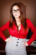 Voluptuous MILF in glasses Kianna Dior stripping off her suit and lingerie