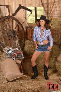 Brunette Euro babe Billie Star exposing big tits in cowgirl boots and hat