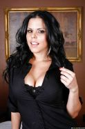 Big busted latina babe Diamond Kitty stripping off her clothes