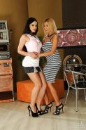 Hot lesbian Abbie Cat is into fervent strapon action with her friend