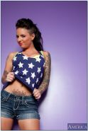 Busty tattooed teen babe Christy Mack stripping off her clothes