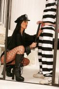 Brunette policewoman Black Angelika dominating male prisoner in jail cell