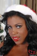 Fat black chick Maserati taking cumshot on big tits after Christmas handjob