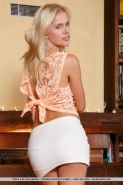 Blonde babe Tracy A revealing tiny teen tits during glamour photo shoot