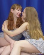 Lactating lesbian squirts milk on girl