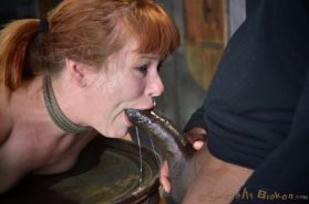 Claire Robbins redhead is bound to a barrel