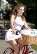 Kelly Brook showing her panties while riding bike in mini skirt