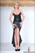 Elegant british mature dominatrix in tight black rubber dress