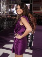 Selena Gomez leggy wearing little purple dress at 'Never Say Never' premiere in