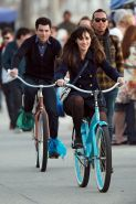 Zooey Deschanel upskirt while cycling in mini skirt  pantyhose on the 'New Girl'