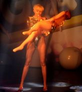 Miley Cyrus giving a blowjob to a blow up doll on stage at GAY Club in London