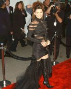 Shania Twain posing very sexy in fuckme boots and in see thru