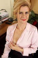 Horny cock starved mature strips naked in her office